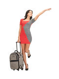 Hitch-hiking woman with suitcase. Bright picture of hitch-hiking woman with suitcase Stock Image