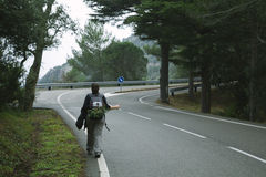 Hitch hiking woman Stock Images