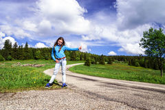 Hitch-hiking by young teenage girl Stock Image