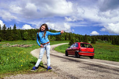 Hitch-hiking by young teenage girl Stock Images