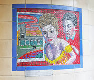 Hitchcock Murals In London. Mural from Hitchcock movie Rebecca is one of 17 mosaics,on display in the entrance corridors of Leytonstone tube station in London Royalty Free Stock Images