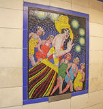 """Hitchcock Murals in London. Mural from Hitchcock movie """"the Pleasure Garden"""" is one of 17 mosaics on display in the entrance corridors of Leytonstone tube Royalty Free Stock Photography"""