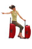 Hitchhike. Young teenager with huge luggage and waves for a taxi Royalty Free Stock Photos