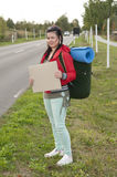Hitchhiker with blank sign Stock Images