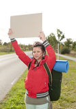 Hitchhiker with blank sign Royalty Free Stock Photos