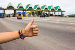 Hitchhiker. A Hitchhiker in front of highway tolls in Malaysia royalty free stock images