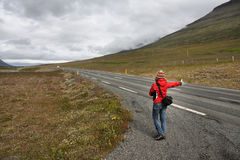Hitchhiker girl Stock Photo