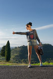 Hitchhiker girl Royalty Free Stock Photo