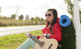 Hitchhiker with guitar Royalty Free Stock Photos