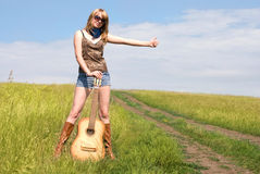 Hitchhiker with a guitar Stock Photography