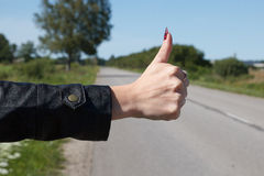 Hitchhiker Holding out his Thumb Royalty Free Stock Photos