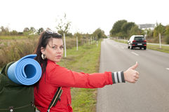 Hitchhiker on the road Royalty Free Stock Image