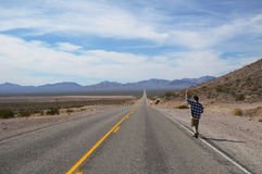 Hitchhiker on a road Stock Photography