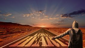 Hitchhiker on road with message Royalty Free Stock Image