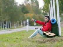 Hitchhiker shows thumb up Stock Photos