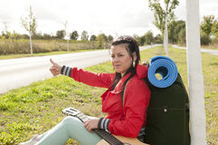 Hitchhiker shows thumb up Royalty Free Stock Photo