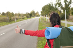Hitchhiker shows thumb up Royalty Free Stock Photography