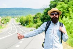 Hitchhiker with special gesture. Man try stop car thumb up. Hitchhiking one of cheapest ways traveling. Hitchhikers risk. Being picked up by someone who is Stock Photography