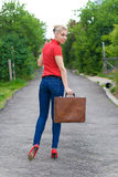Hitchhiker with suitcase Royalty Free Stock Images