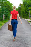Hitchhiker with suitcase Stock Image