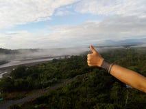 Hitchhiker traveler. Backpacker travel Amazonas. Adventure, positivism and fun Stock Photography