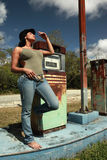 Hitchhiker at a vintage gas station Stock Images