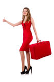 Hitchhiker woman in red dress with suitcase Royalty Free Stock Image
