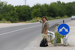 Hitchhiker. Young hitchhiker hopes to transport Royalty Free Stock Photo