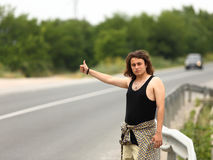 Hitchhiker. Young hitchhiker hopes to transport Royalty Free Stock Images