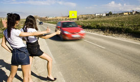 Hitchhikers on the road stock photo