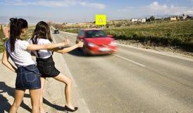 Hitchhikers sulla strada Fotografia Stock