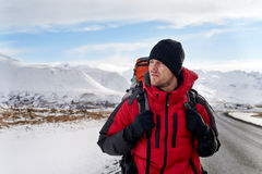 Hitchhiking backpacker in iceland Stock Photography