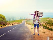 Hitchhiking couple, hitchhikers travels anywhere. Hitchhiking couple holds blank cardboard, happy hitchhikers travels anywhere. Hitchhike adventure of young men Stock Photography