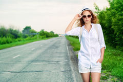 Hitchhiking girl Royalty Free Stock Photo