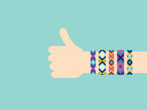 Hitchhiking hand with hippy friendship bracelets Royalty Free Stock Photo