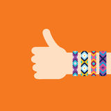 Hitchhiking hand with hippy friendship bracelets Royalty Free Stock Photography
