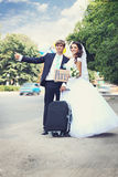 Hitchhiking in a honeymoon, tinted Royalty Free Stock Photography