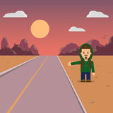 Hitchhiking. A man with a backpack hiker. Mountain landscape and sunset Royalty Free Stock Photography