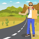 Hitchhiking man with backpack and sunglasses holding cardboard standing on highway. Adventure and tourism concept. Royalty Free Stock Photos