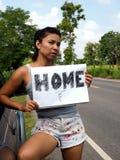 Hitchhiker woman wearing denim shorts Stock Image