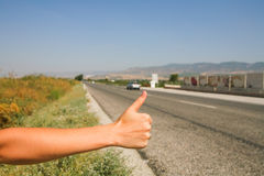 Hitchhiking the road Royalty Free Stock Images