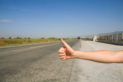 Hitchhiking the road Royalty Free Stock Photos