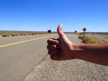 Hitchhiking in a road of Argentina Stock Photos