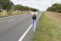 Hitchhiking the road. Royalty Free Stock Photo