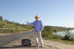 Hitchhiking travel man at the route Royalty Free Stock Images