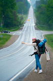 Hitchhiking travel Stock Images