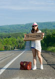 Hitchhiking travel Stock Photography