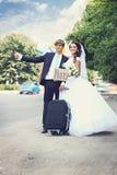 Hitchhiking w miesiącu miodowym, zabarwiającym Fotografia Royalty Free