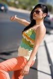 Hitchhiking Woman. Beautiful young hispanic woman hitchhiking Royalty Free Stock Photography