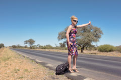 Hitchhiking woman Royalty Free Stock Photo